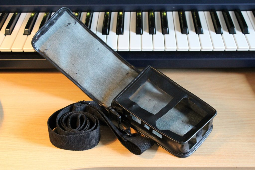 Tascam GameBoy carry case open, empty showing interior