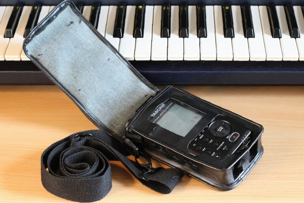 Tascam GameBoy carry case open, containing DR100 mkiii and showing buttons/interface matching the pre-cut holes